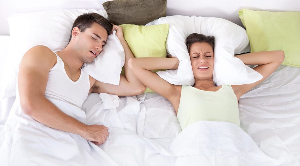 young couple snoring