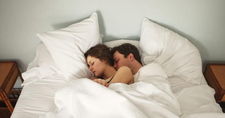 Couple in bed sleeping